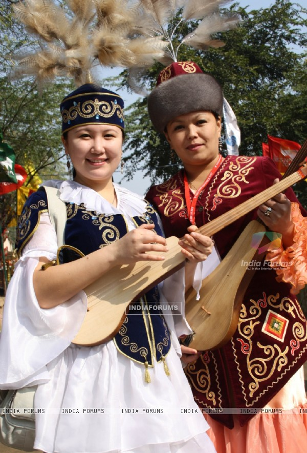 Folk artists from Kazakhstan at the 26 th Surajkund Craft Mela ,Faridabad on Wednesday-IANS Photo by Amlan Paliwal.