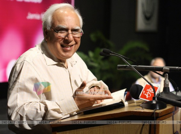 A poet and Union Minister Kapil Sibal reading a his poem at Jamia Millia Islamia University,in New Delhi on Tuesday. .