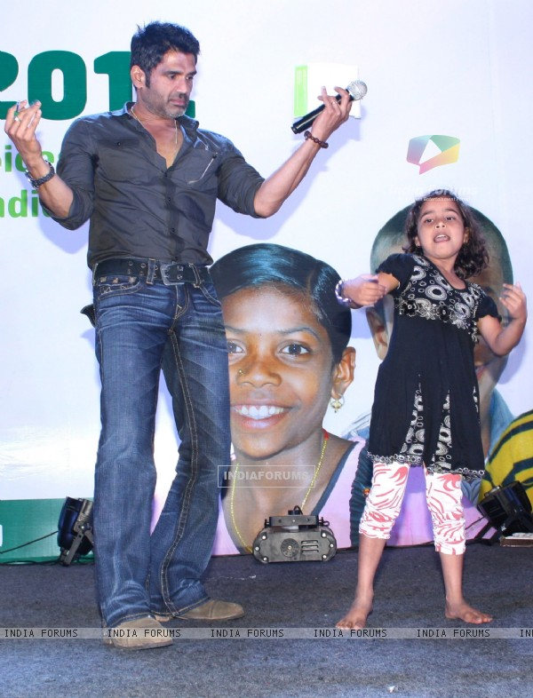 Bollywood actor Sunil Shetty with underprivileged children at the ChildFun day organized by ChildFund India, in New Delhi on Wednesday. .