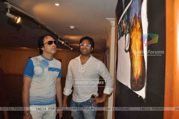 Cast promoting upcoming film 'BANDOOK' at a Painting Exhibition
