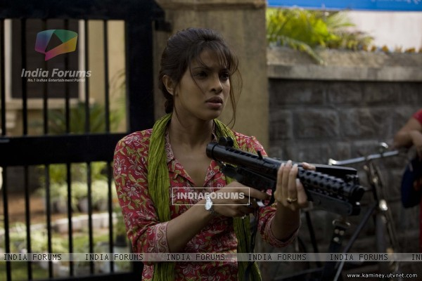 Priyanka Chopra with a rifle