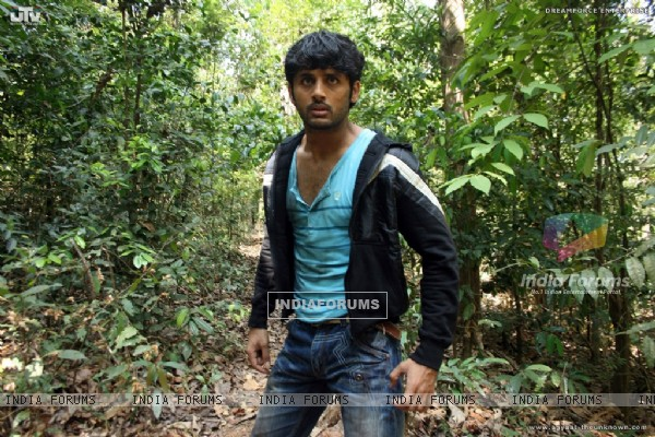 Nitin Reddy standing in a jungle (20400)