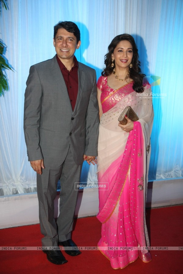 Madhuri Dixit with husband Dr Sriram Nene at Esha Deol's Wedding Reception