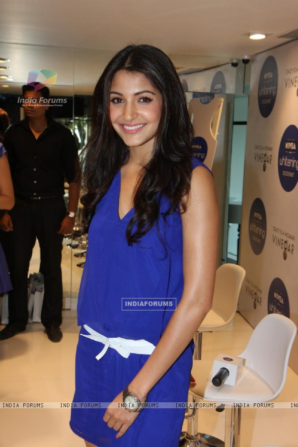 Anushka Sharma gestures during the launch of Nivea's Go Sleeveless Campaign in Mumbai