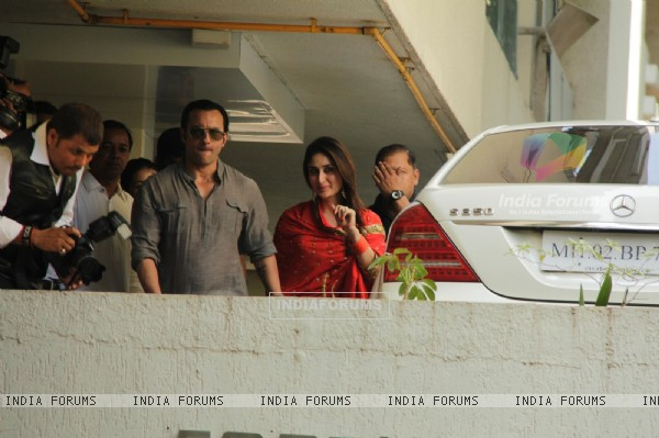 Saif Ali Khan with wife Kareena Kapoor gestures after their marriage