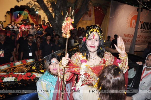 Radhe Guru Ma and Dolly Bindra on Navami at the DN Nagar Durga Puja in Mumbai.