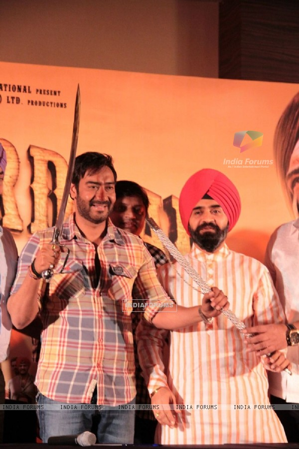 Bollywood actor Ajay Devgan and Congress leader Charan Singh Sapra at Son Of Sardaar press meet to resolve issues with Sikh Community leaders at Hotel Novotel in Juhu, Mumbai.