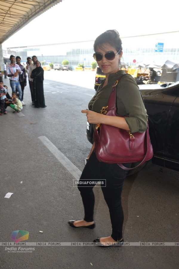 Bollywood actress Asin snapped at Mumbai International Airport leaving for Dubai.