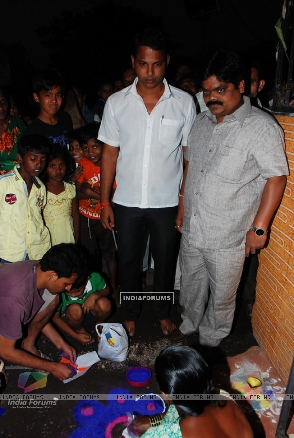 Shankar Nangre distributing Sweets and Fire Crackers to the underprivileged children