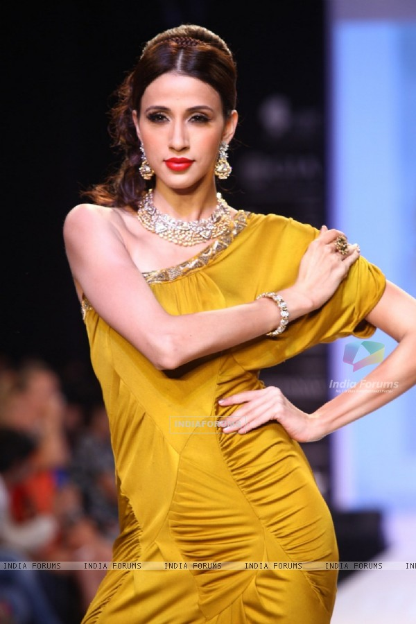 Kristina Akheeva walks the ramp at IIJW 2013 Day 4