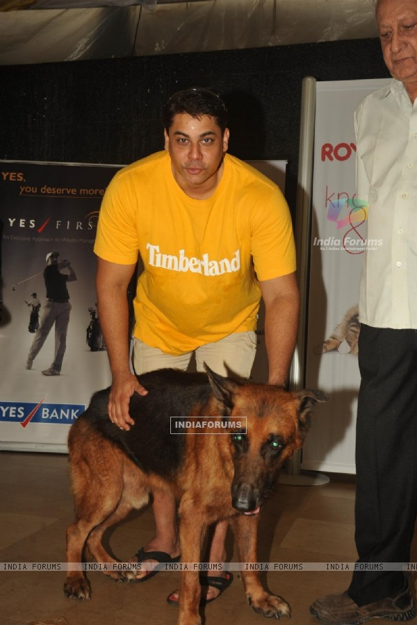 Cyrus Brocha with his Dog at the Pawsitive People's Awards