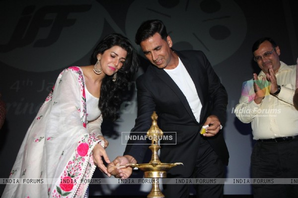 Nimrat Kaur and Akshay Kumar light the inaugral lamp at the Jagran Film Festival 2013
