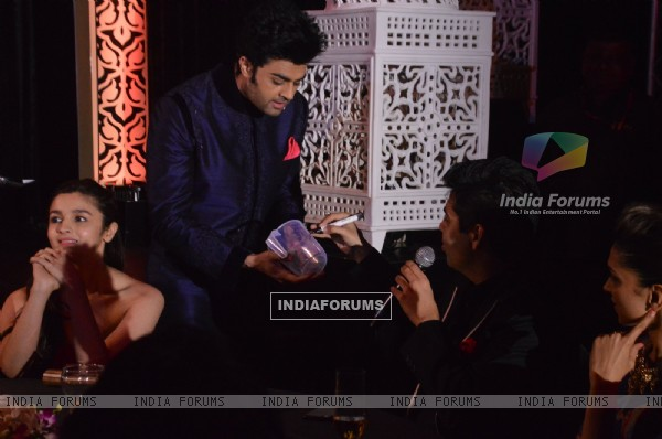 Manish Paul jokes around with Karan Johar at the 59th Idea Filmfare Pre Awards Party