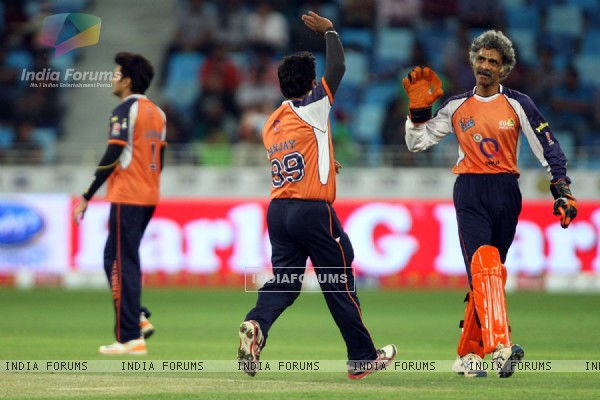 The Veer Marathi team celebrates a wicket taken
