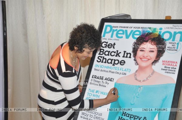 Manisha Koirala signs the cover of health magazine Prevention