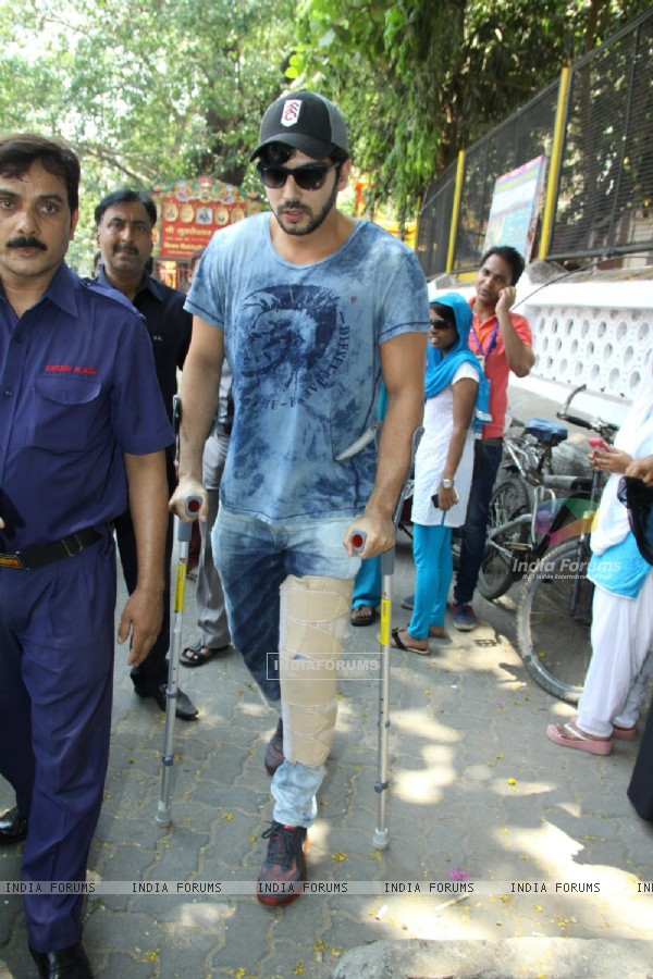 Zayed Khan arrives with a broken leg to cast his vote at a polling station in Mumbai