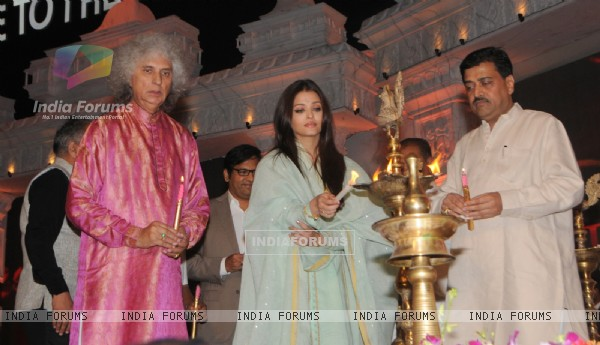Aishwarya Rai lights the lamp at the Tribute to the Legend of Pure Love concert