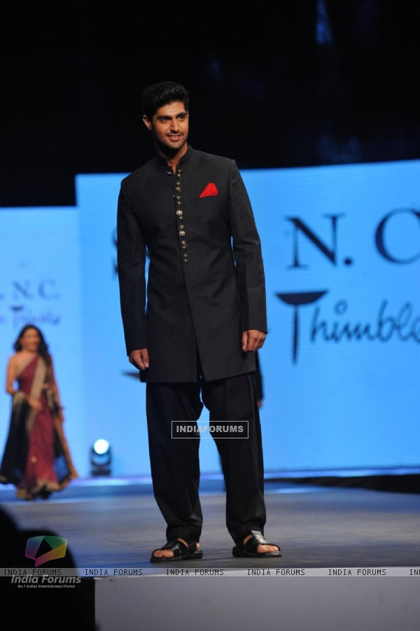 Tanuj Virwani walked the ramp at the 'Caring with Style' fashion show at NSCI