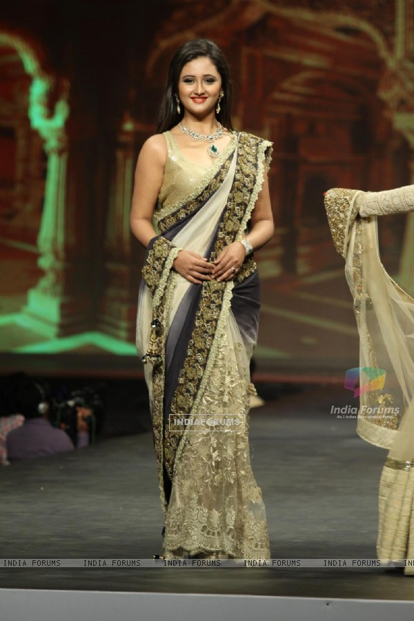 Rashmi Desai walks the ramp at the 'Caring with Style' fashion show at NSCI