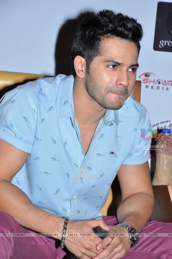 Varun engrossed in questions at the Press Meet