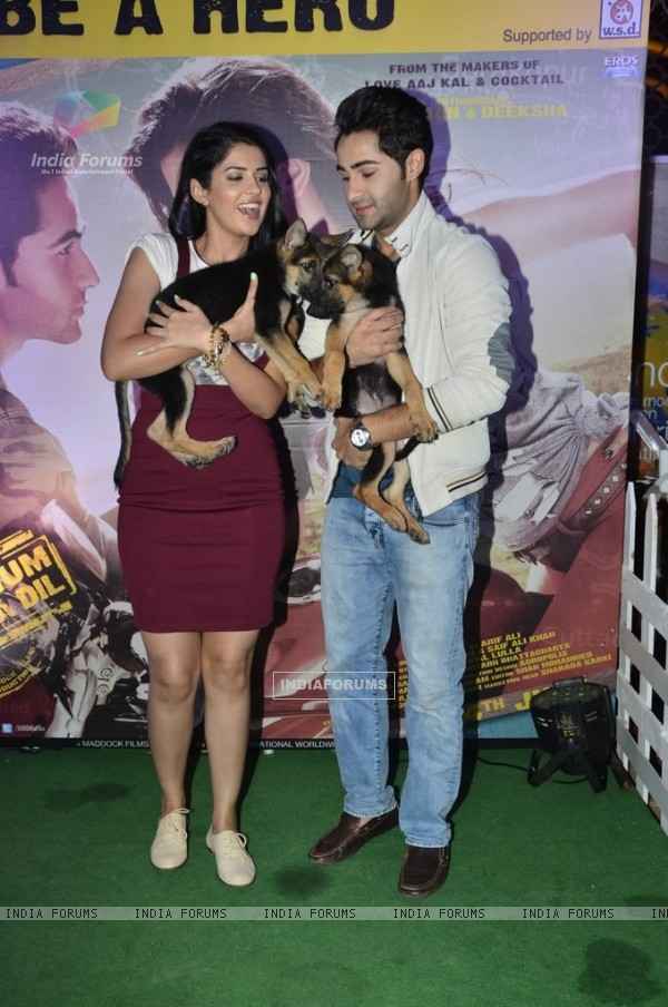 Armaan and Deeksha pose with puppies