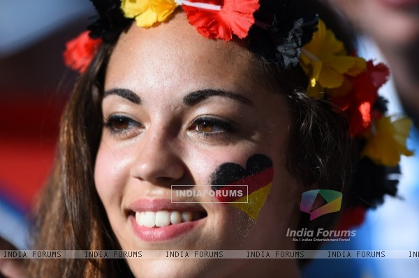 A fan paints the German flag on face
