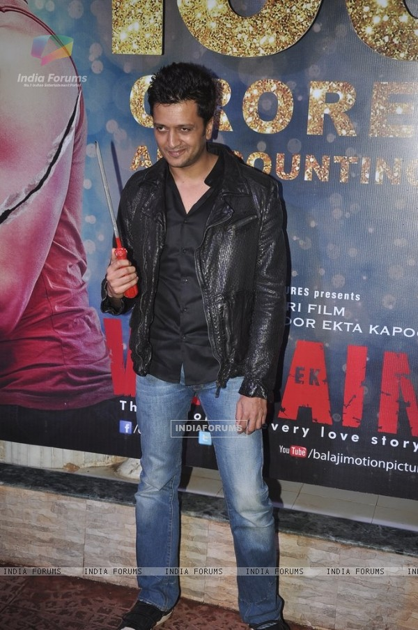 Riteish Deshmukh poses with a prop at the Success Bash of Ek Villain