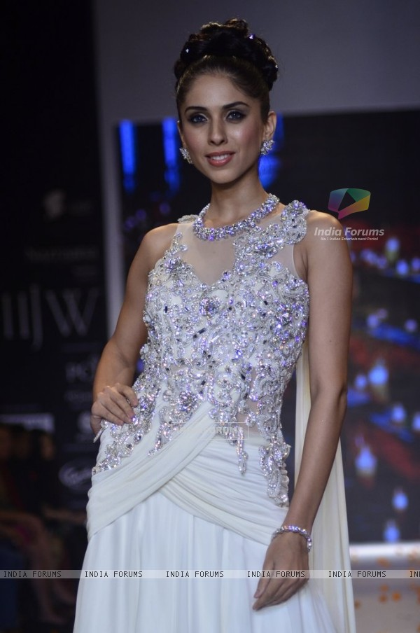 A model walks the ramp as a bride's maid at the IIJW 2014 - Day 2