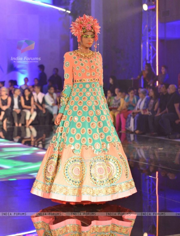 A model walks the ramp at the Indian Couture Week - Day 4