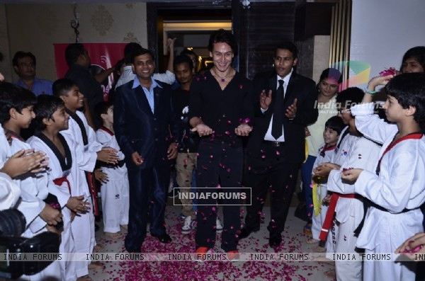 Tiger Shroff was given a floral welcome by the students