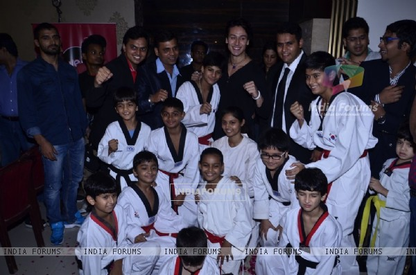 Tiger Shroff poses with the students