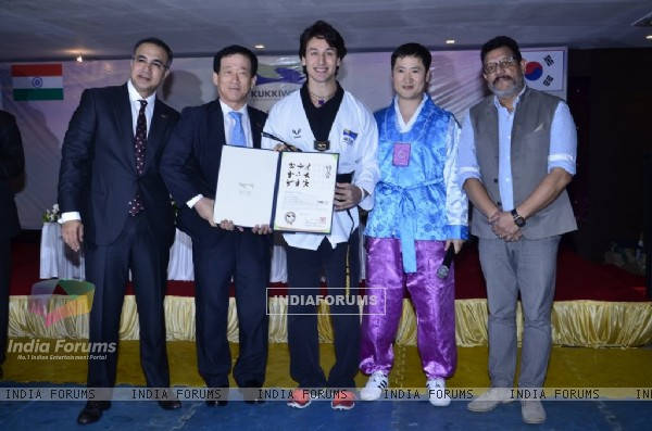 Tiger Shroff receiving his award at the Kukkiwon Award Ceremony