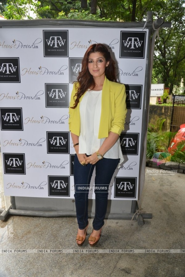 Twinkle Khanna poses for the media at The White Window