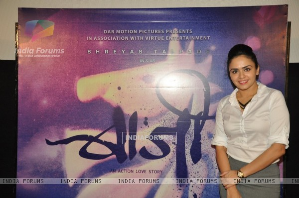 Amruta Khanvilkar poses with the poster of Baji at the First Look Launch