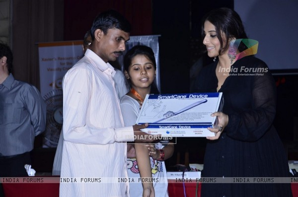 Vidya Balan presents Smartcane Device to a Visually Impaired man