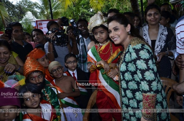 Rani Mukherjee poses with fancy dressed students at the Promotion of Mardaani at a Local School