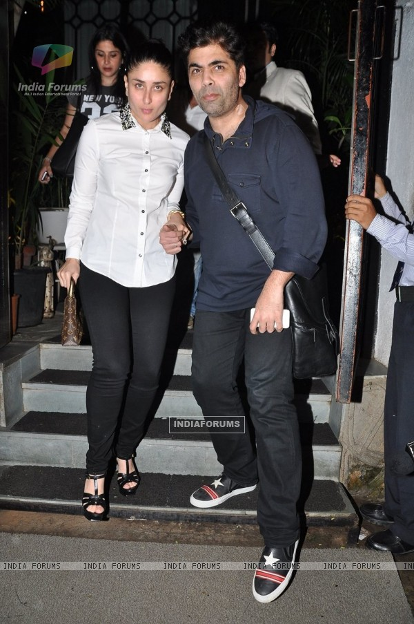 Karan Johar and Kareena Kapoor poses for the media at Nido