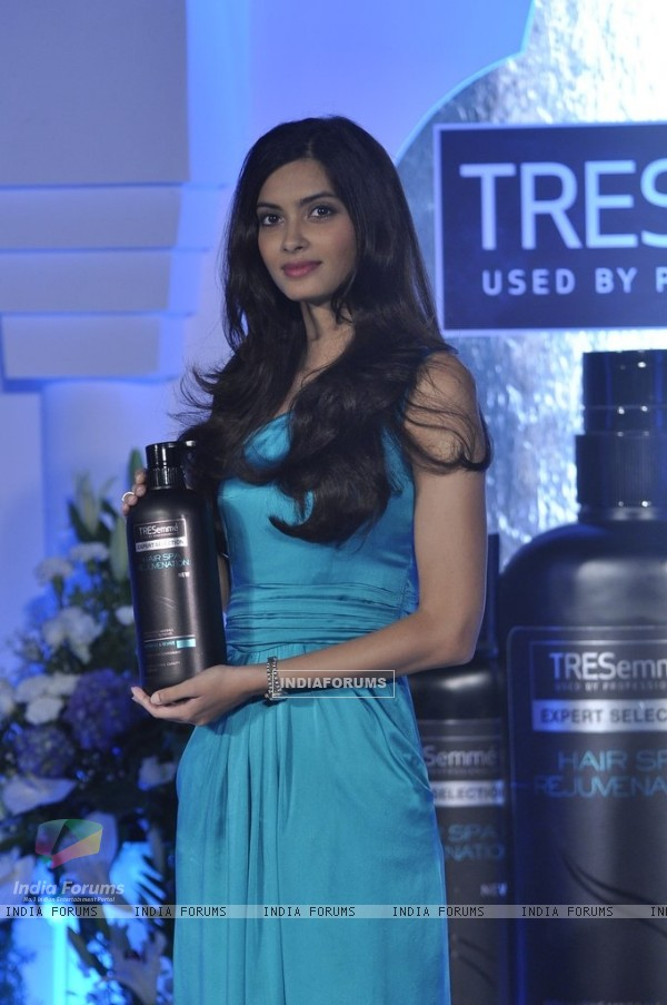 Diana Penty poses for the media with Tresseme products at the endorsement event