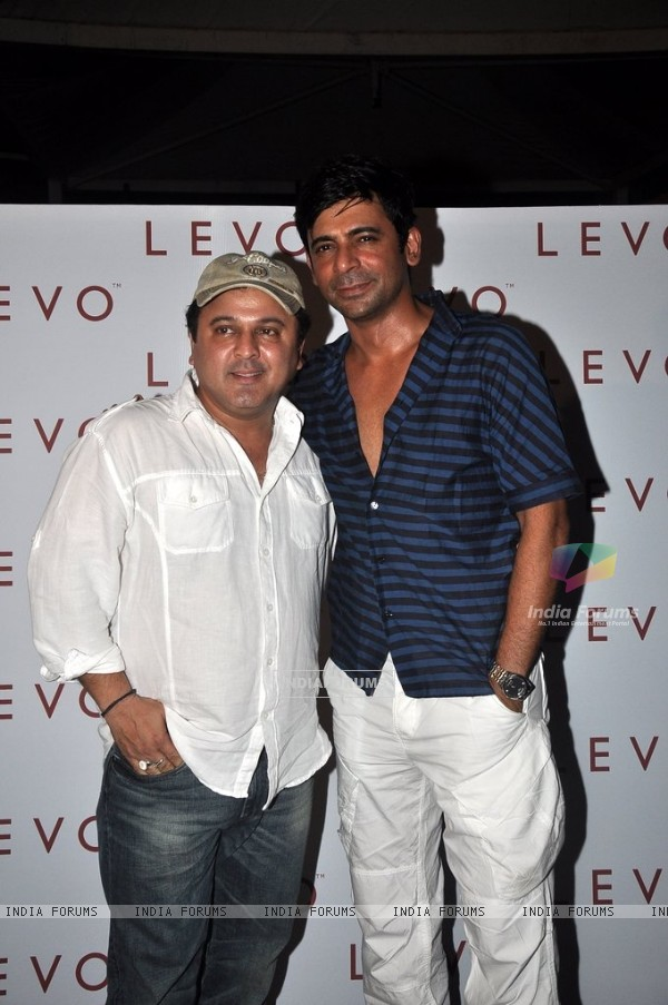 Ali Asgar and Sunil Grover pose for the media at Melissa Pais Birthday Bash