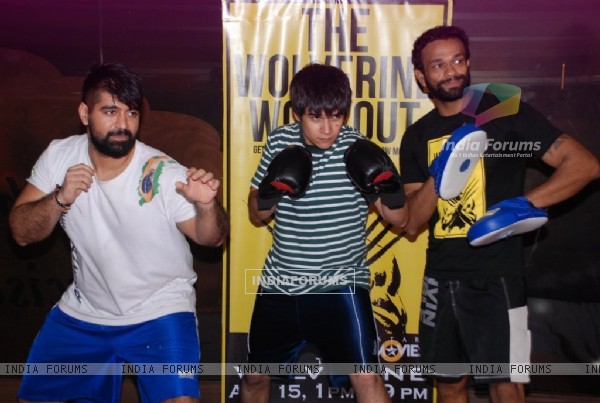 Vivaan Shah practices with friends at the Gold Gym Wolverine Workout