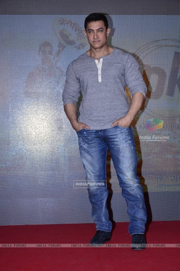 Aamir Khan poses for the media at the Second Poster Launch of P.K.