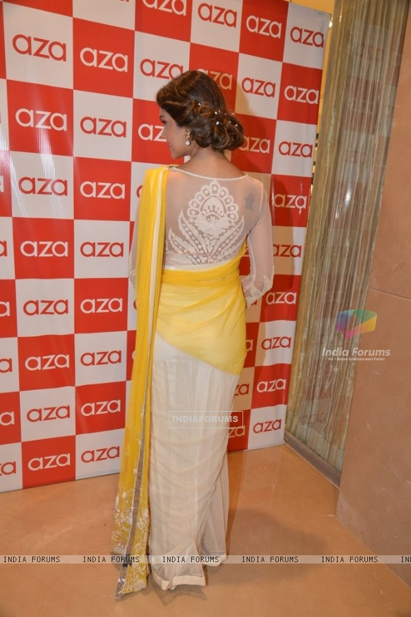 Esha Gupta shows off her outfit at the Aza Store Launch