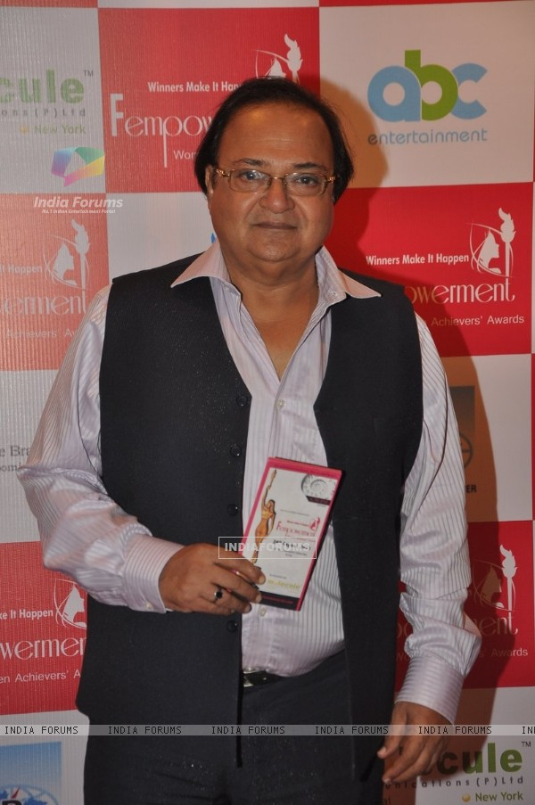 Rakesh Bedi poses for the camera at Fempowerment Awards 2014