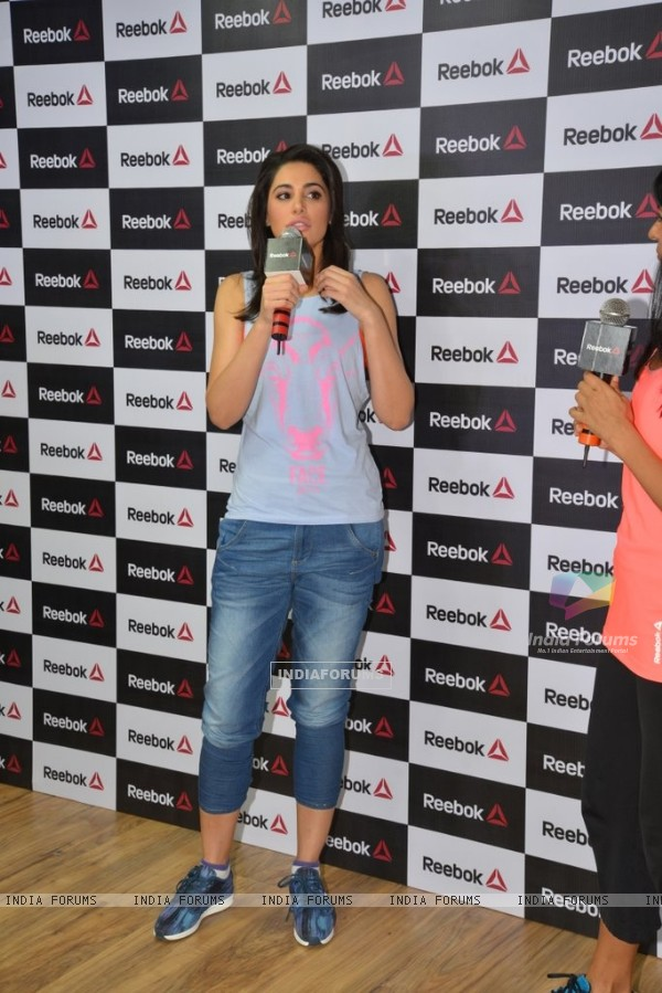 Nargis Fakhri addressing the media at the Press Meet of Reebok