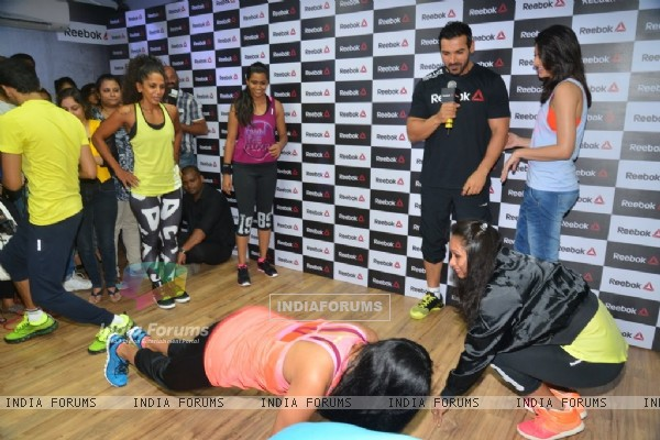 Fitness Trainer showcases push up exercise at the Press Meet of Reebok
