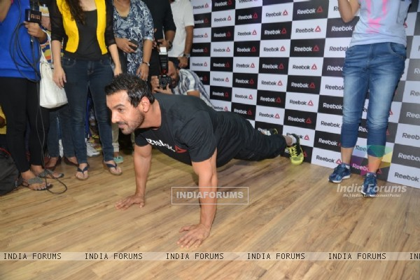 John Abraham does a push up exercise at the Press Meet of Reebok