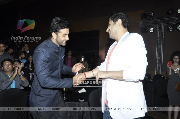 Ranbir Kapoor greets DJ Khushi at the Success Bash of Saavn Mobile App