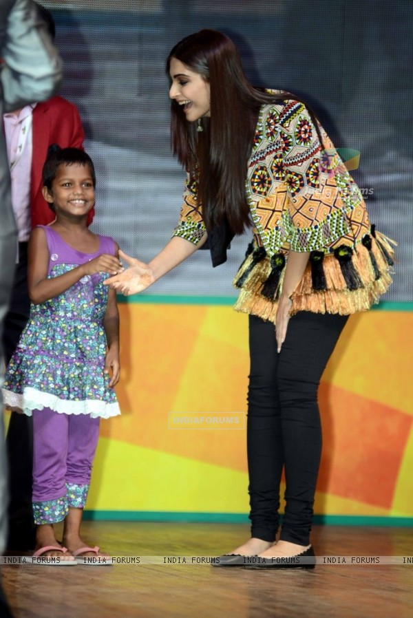 Sonam Kapoor greets a young fan at the Promotions of Khoobsurat in Delhi