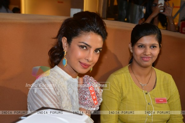 Priyanka Chopra sports a stitched hand gear at the Promotions of Mary Kom at Usha World