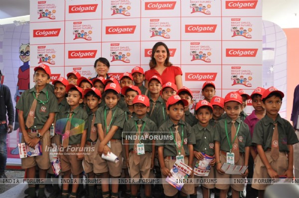 Lara Dutta poses with kids at the Colgate Bright Smiles Celebration